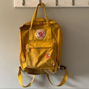Yellow Fjallraven Kanken backpack